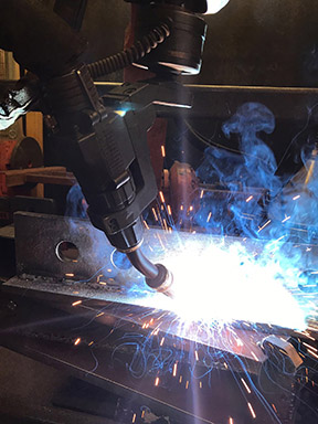 Robotic arm performing a weld