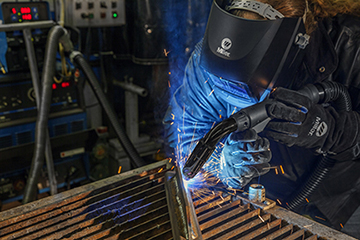 Image of live welding with a Clean Air fume extraction MIG gun