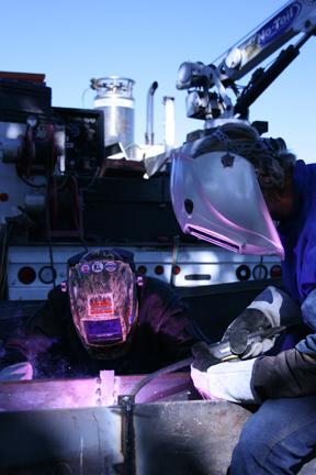 Image of two welders on a jobsite, welding in a flux cored application