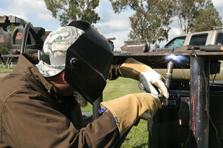 Image of a person welding in an out of position welding application