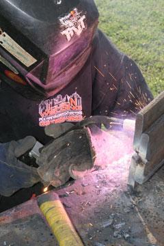 Image of a welder from Jolson Welding, welding with a Dura-Flux MIG gun