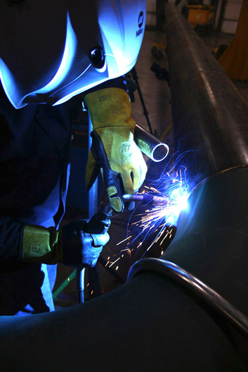 Image of a person welding with a MIG gun