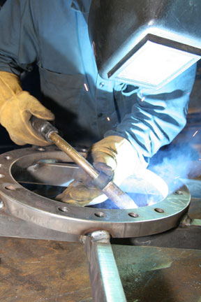 Image of an OEM welding with a MIG gun