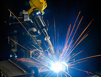 Image of robotic welding with sparks