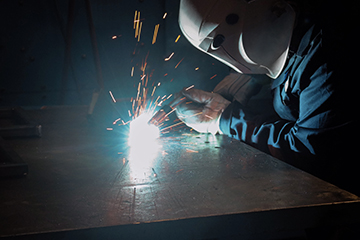 Image of welder, welding in a semi-automatic application