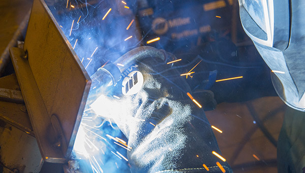 Image of person welding